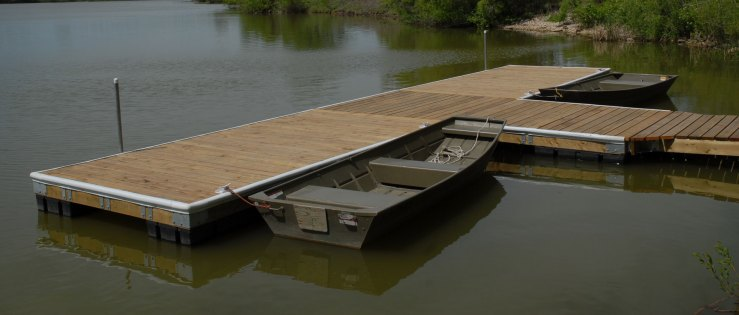 Wood dock with bumpers and rub rails