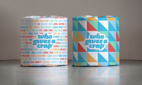Shop: Two rolls of Who Gives a Crap toilet paper in rainbow packaging.