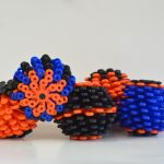 Shop: Four cora balls in black, blue and orange.