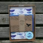 Shop: A stationery set featuring different coloured whale flukes.