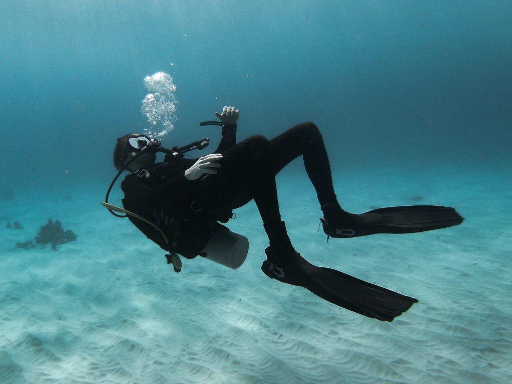 Divemaster blowing bubbles