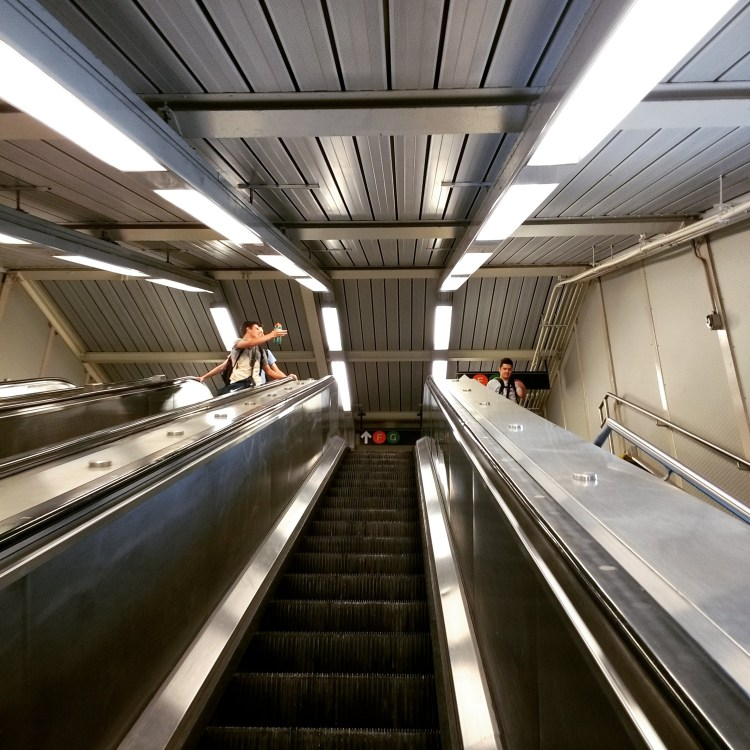 Boys on escalators, copyright Luke Dani Blue