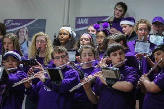 The Anacortes band members play upbeat songs during a timeout.