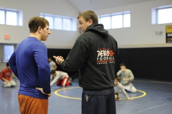 YOKOSUKA, Japan (Jan. 31, 2017) – Fleet Activities (FLEACT) Yokosuka's Nile C. Kinnick High School wrestling team prepares for the Japan Finals, the last home event for the Red Devils scheduled for 9 a.m. Saturday, Feb. 4. FLEACT Yokosuka provides, maintains, and operates base facilities and services in support of 7th Fleet's forward-deployed naval forces, 83 tenant commands, and 24,000 military and civilian personnel. (Photo by Kristina Mullis/170131-N-LV456-010 Released by FLEACT Yokosuka Public Affairs Office)
