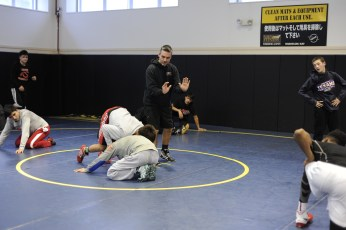 YOKOSUKA, Japan (Jan. 31, 2017) – Fleet Activities (FLEACT) Yokosuka's Nile C. Kinnick High School wrestling team prepares for the Japan Finals, the last home event for the Red Devils scheduled for 9 a.m. Saturday, Feb. 4. FLEACT Yokosuka provides, maintains, and operates base facilities and services in support of 7th Fleet's forward-deployed naval forces, 83 tenant commands, and 24,000 military and civilian personnel. (Photo by Kristina Mullis/170131-N-LV456-012 Released by FLEACT Yokosuka Public Affairs Office)