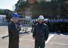 170214-N-YG414-130 YOKOSUKA, Japan (Feb. 15, 2017) - Rear Adm. Marc H. Dalton, Commander, Amphibious Force 7th Fleet, right, talks with Damage Controlman 1st Class Christopher Thibodeau, attached to U.S. 7th Fleet flagship USS Blue Ridge (LCC 19), during an All Hands Call aboard the ship. Blue Ridge is in an extensive maintenance period in order to modernize the ship to continue to serve as a robust communications platform in the U.S. 7th Fleet area of operations. (U.S. Navy photo by Mass Communication Specialist Seaman Patrick Semales/ RELEASED)