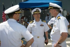 170519-N-NT265-023 SHIMODA, Japan (May 19, 2017) – Capt. Jeffrey Kim, commander, Fleet Activities Yokosuka, is welcomed by Capt. Bennett, commander, Destroyer Squadron 15, and Cmdr. Warren Smith, commanding officer of the forward-deployed Arleigh Burke-class guided-missile destroyer USS Mustin (DDG 89), while coming aboard during the Shimoda Black Ship Festival. The Navy's participation in the festival celebrates the heritage of U.S.-Japanese naval partnership first established by commodore Matthew Perry's 1853 port visit. For more than 160 years, the United States has established a heritage of naval presence in the Indo-Asia-Pacific region to promote partnership, prosperity, and maritime security. (U.S. Navy photo by Mass Communication Specialist 2nd Class Christian Senyk/Released)