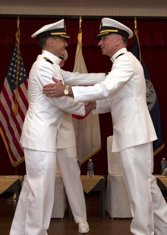170607-N-HE318-073 YOKOSUKA, Japan (June 7, 2017) Capt. James Lucci, right, outgoing commanding officer, Defense Service Office (DSO) Pacific, congratulates Capt. David Harrison, left, incoming commanding officer, DSO, during a change of command ceremony in the Fleet Activities (FLEACT) Yokosuka Officer's Club. Attorneys with DSO provide legal representation and advice to military service members on defense-related topics. (U.S. Navy photo by Mass Communication Specialist 2nd Class William McCann/Released)