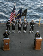 """170715-N-PJ626-039 CORAL SEA (July 15, 2017) Capt. Paul Lanzilotta, executive officer of the Navy's forward-deployed aircraft carrier, USS Ronald Reagan (CVN 76), and Cmdr. David Yang, command chaplain, preside over a burial-at-sea ceremony for Julius """"Harry"""" Frey and his wife, Jerry, aboard Ronald Reagan during Talisman Saber 2017. Frey, a WWII veteran, served aboard USS Lexington (CV 2) during the Battle of Coral Sea and his ashes were laid to rest at the coordinates where the ship sank. Talisman Saber is a realistic and challenging exercise that brings service members closer and improves both U.S. and Australia's ability to work bilaterally and multilaterally, and prepares them to be poised to provide security regionally and globally. (U.S. Navy photo by Mass Communication Specialist 3rd Class Kaila Peters/Released)"""