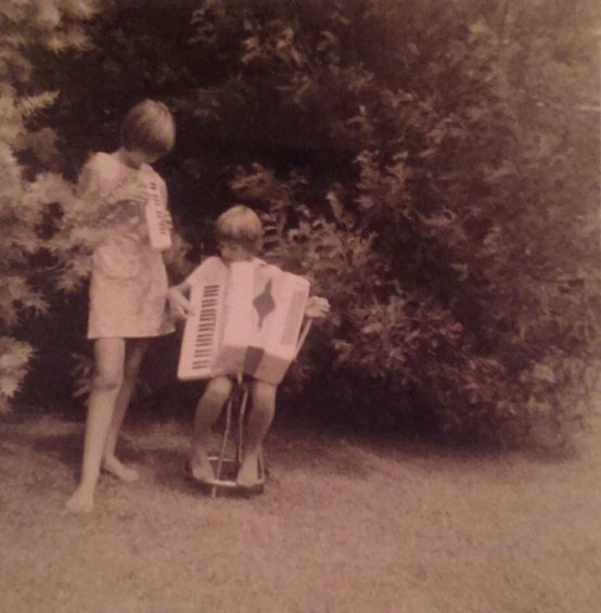 Submitted by Desiree Goodall, 1965, New Zealand - My mum (on the left), about 9 years old, on holiday with her cousin in Auckland. The dress was made by my nana, from a pale blue and purple paisley fabric.