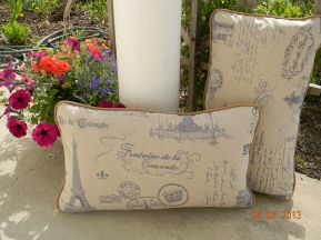 piped and zippered linen/cotton blend lumbar pillows.