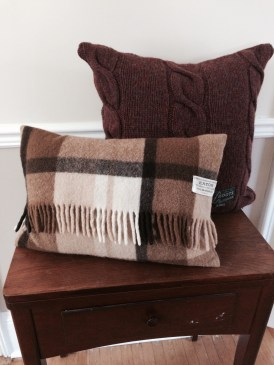 """1 of 4 fringed lumbar wool pillows with a nice rusty Shetland wool """"Roots"""" Canada upcycled sweater behind. 2015"""