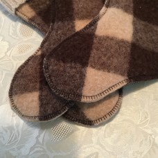 Close up of blanket stitching on felted wool blanket stocking