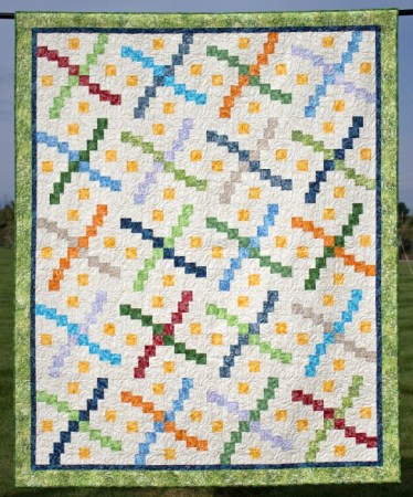 5 Fast and Easy Scrap Quilts you Can Do While at Home featured by top US quilting blog and shop, Seams Like a Dream Quilt Designs: Whirlybird a great scrap quilt