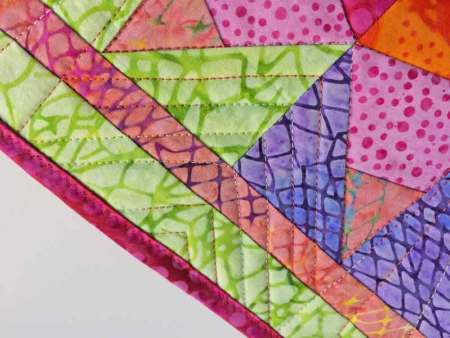 Island Batik paper piecing Project featured by top US quilting blog and shop, Seams Like a Dream Quilt Designs