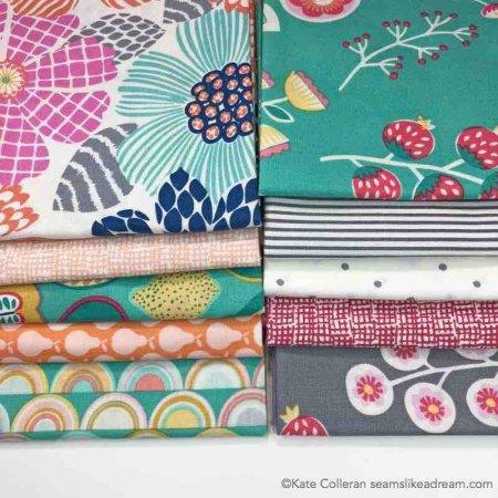 a pile of dear stella fabrics