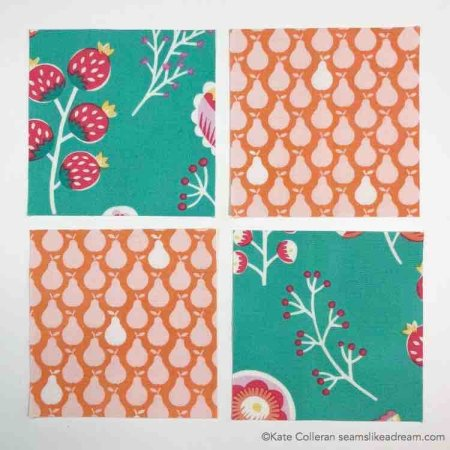 Four patch block in orange and green prints