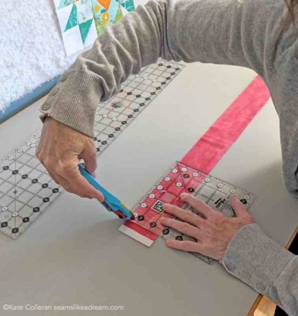 Tips for Cutting Fabric featured by top US quilting and sewing blog and shop, Seams Like a Dream Quilt Designs: demonstrates what NOT to do when cutting fabric!