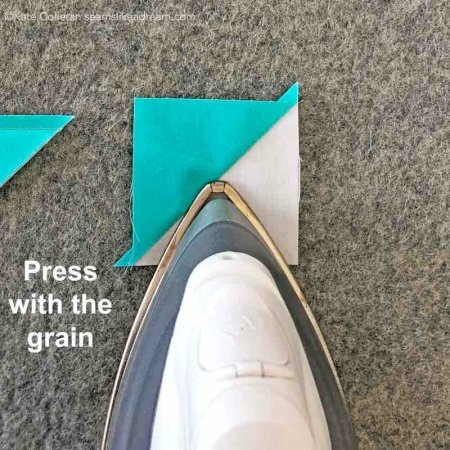 5 Tips for Pressing Quilt Seams featured by top quilting and sewing shop, Seams Like a Dream Quilt designs, explains why pressing with the grain of the fabric matters when you quilt.