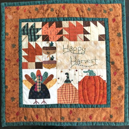 Thanksgiving quilt featured by top US quilting blog Seams Like a Dream Quilt Designs