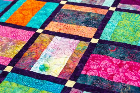 Top US quilting blog and shop, Seams Like a Dream Quilt Designs, shares a new batik fabric line Painted Blossoms!