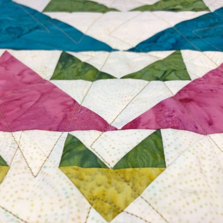 Top US quilting blog and shop, Seams Like a Dream Quilt Designs, shares her new star quilt pattern Novalie!