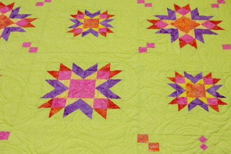 Top US quilting blog and shop, Seams Like a Dream Quilt Designs, shares her new star quilt design Astria!