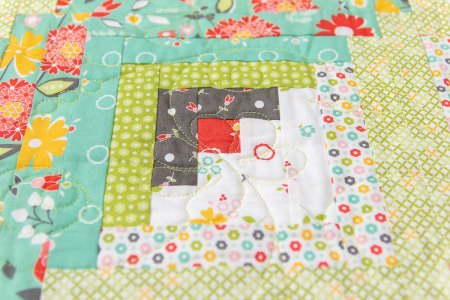 Top US quilting blog and shop, Seams Like a Dream Quilt Designs, shares about the Log Cabin quilt block!