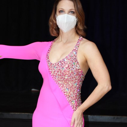 Christina Musser, dance instructor at Spotlight Ballroom, wears a consistent design Latin dance dress made of stretch crepe and mesh