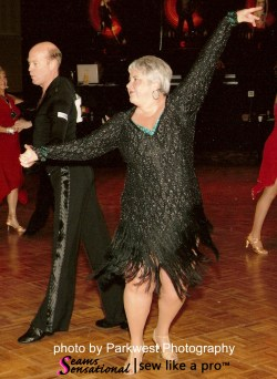 black fringe Dancesport dress, photo by Parkwest Photography. Teresa Sigmon shares tips on choosing, making or altering competition Dancesport, Country of Skate dresses.