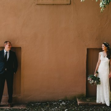 Bride and groom stand apart looking at each other outside a downtown Portland Oregon Wedding Venue