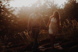 sunny haze fills a warm embrace between a couple during their oregon engagement photos
