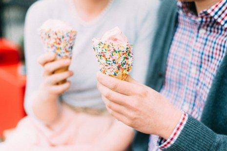 Couple holds ice cream during their fifties styled engagement shoot