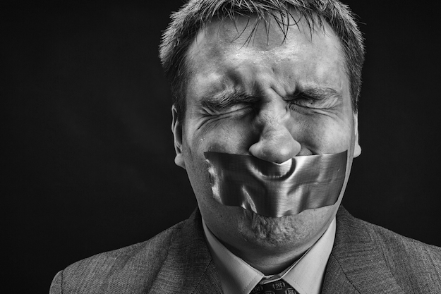 An average Canadian bureaucrat's response to questions from the news media. (Photograph by Shutterstock.com)