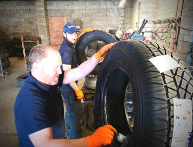 Inspecting a tyre at Sean McManus Tyres