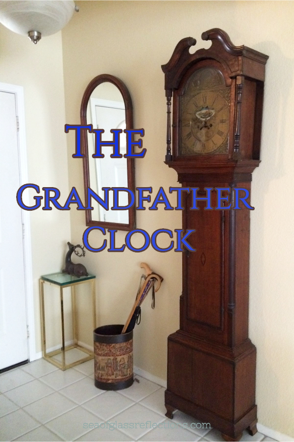 A grandfather clock in a white tile hallway.