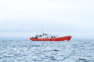 red boat in ocean