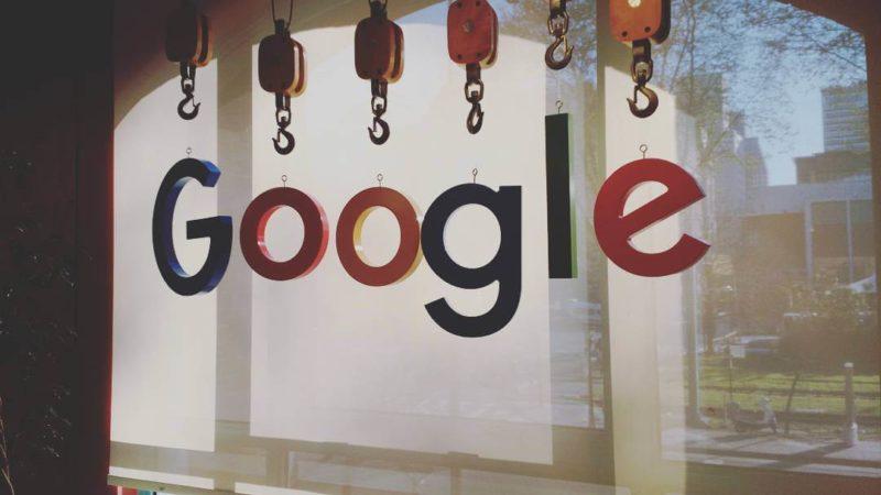 google-logo-hanging-by-crane-lifting-hooks