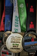 Some of our Ironman's collection of finisher's medals