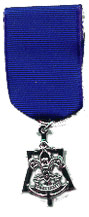 Skipper's Key award (medal hanging from a blue ribbon)