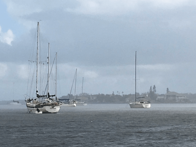 sailboats along the Indian River in the rain