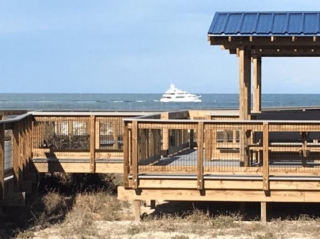 Yacht traveling along the coastline