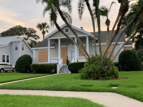 House boarded up with plywood for Hurricane Dorian