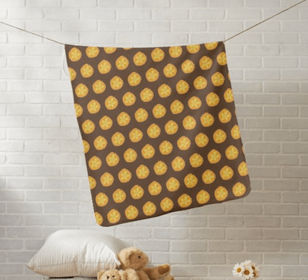 Brown baby blanket with yellow sand dollars pattern