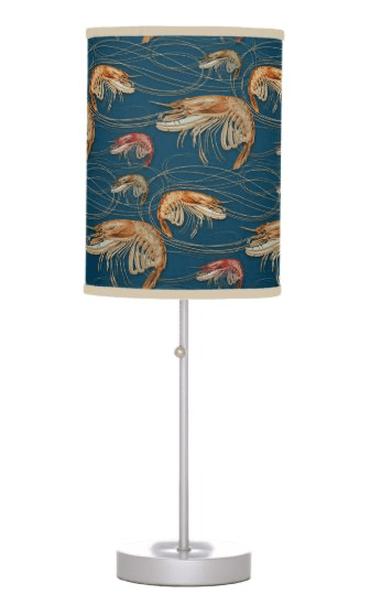 Table lamp with shrimp pattern shade on dark blue