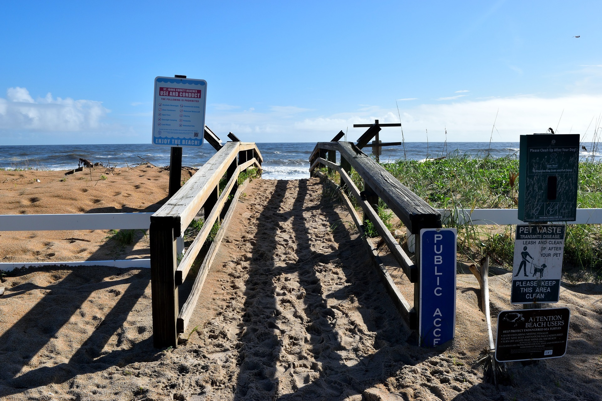 beach access ramp for people to walk on with signage