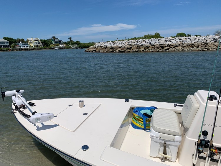 boat at island inlet saltwater boating Hewes Redfisher