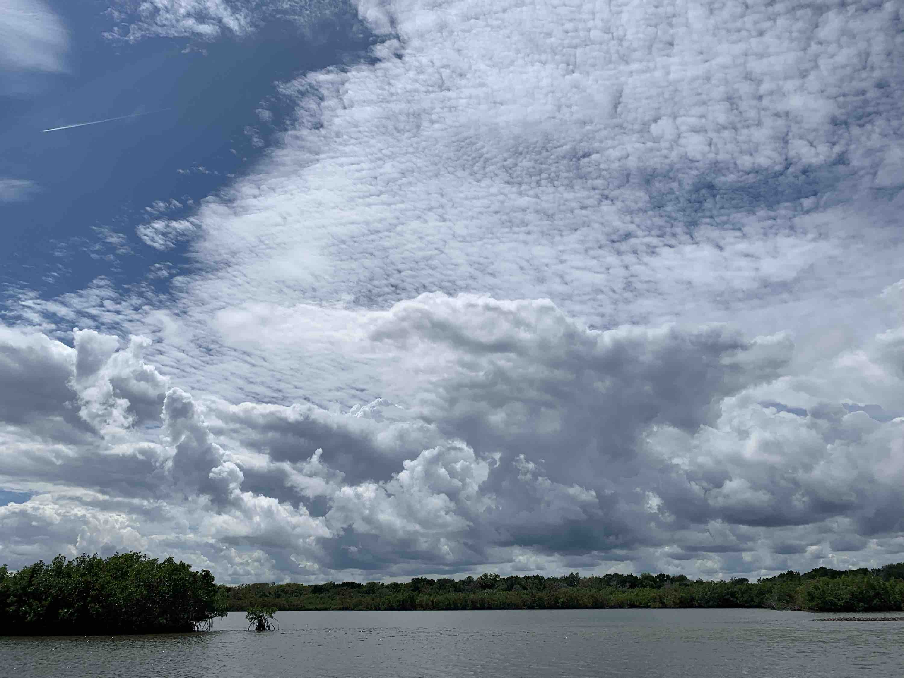 clouds gathering and building over the Indian River