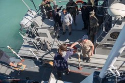 Captain Oona greets the Navy captain who helps SSCS retrieve illegal net. Photo: Carolina A Castro