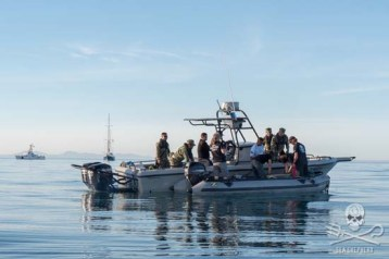 Crew delivers the illegal long line and hooks to the navy for destruction of poaching material. Photo: Carolina A Castro